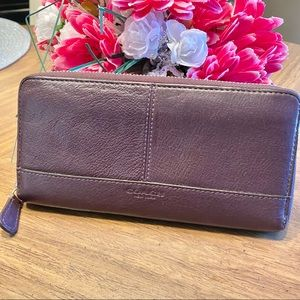 COACH leather accordion wallet in a deep eggplant